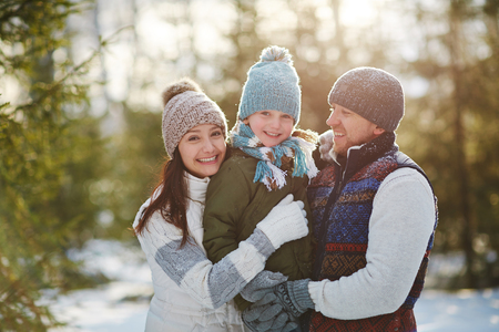 Portrait of happy family outdoors in winter Stock Photo