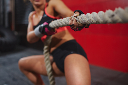 contest: Hands of strong woman pulling rope