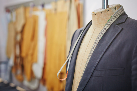 New jacket on mannequin and measuring tape 스톡 콘텐츠