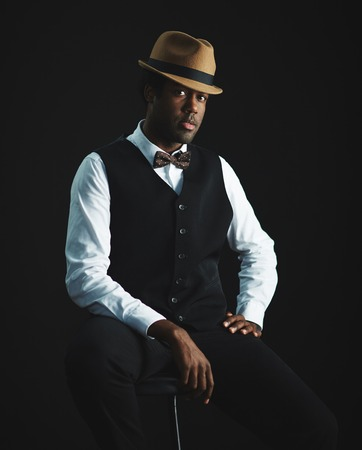 only 1 man: Elegant man in hat and smart clothes looking at camera Stock Photo