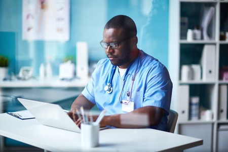 clinician: Young clinician in uniform networking Stock Photo