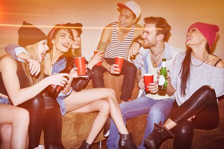 clubber: Happy young people laughing at swag party in bar