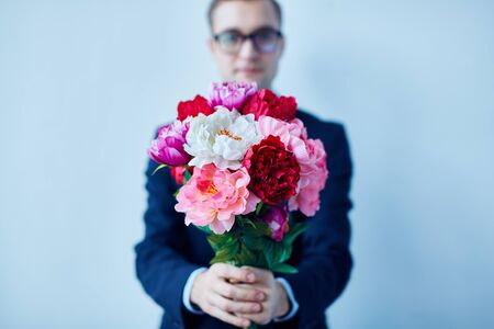 peony: Young man giving peony bouquet