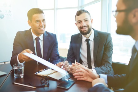 negotiation business: Successful businessmen striking deal after negotiation Stock Photo