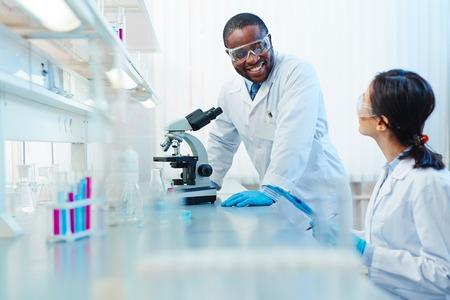 Modern biochemists working together in scientific laboratory