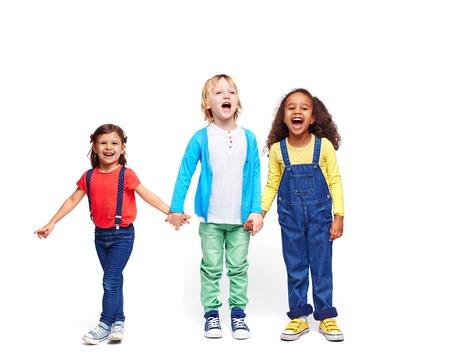 multi ethnic children: Adorable kids in casual-wear expressing joy