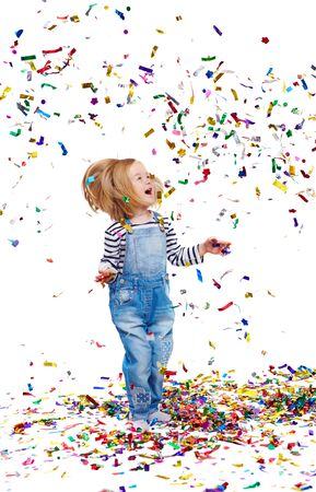 ecstatic: Ecstatic girl playing with confetti while standing on the floor