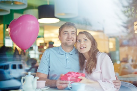 Charmed valentines celebrating Valentine day in cafe Stock Photo