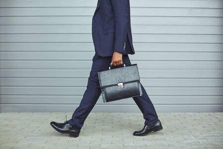 man at work: Legs of businessman in suit walking to work in the morning
