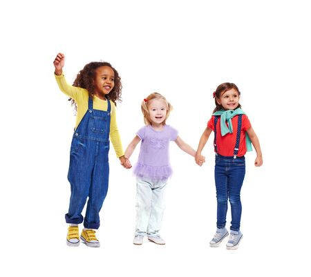 carefree: Joyful and carefree little girls holding by hands Stock Photo