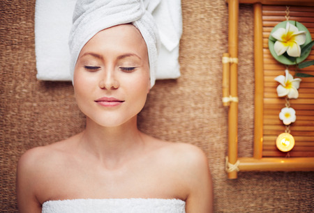 beautician: Young woman with closed eyes relaxing in beauty salon Stock Photo