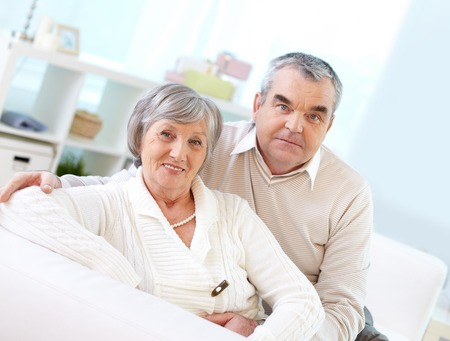elderly adults: Mature woman and her husband looking at camera