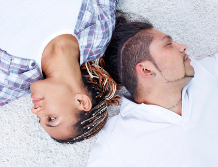 Happy young dates lying on the floor photo