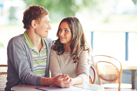 boy lady: Young smiling couple having rest in cafe Stock Photo