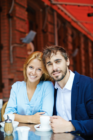 amorous: Amorous young couple having coffee in cafe