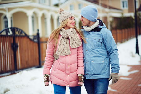 sweethearts: Young sweethearts in winter-wear talking outdoors