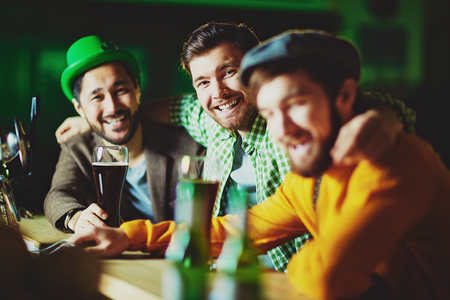 people looking: Friendly men celebrating St. Patrick day Stock Photo