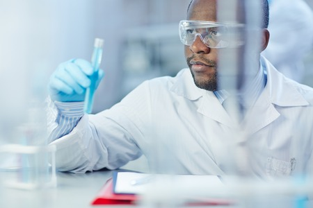 Modern scientist studying new virus in lab Stock Photo