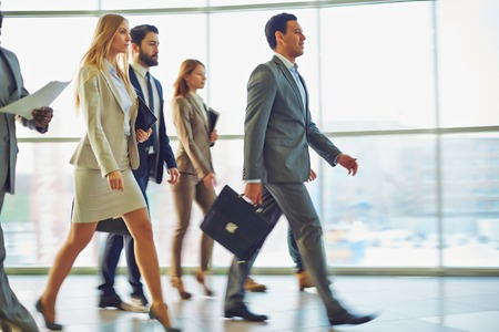 crowd people: Crowd of business people going down corridor of office building in the morning Stock Photo