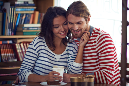 amorous woman: Amorous valentines spending time in cafe Stock Photo