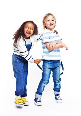 cute little girl smiling: Ecstatic little friends in casual-wear