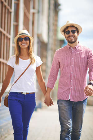 amorous woman: Young tourists sightseeing in urban environment
