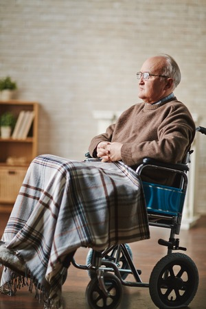 mobility nursing: Mature man on wheelchair staying at home