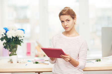 touchpad: Serious designer with touchpad looking at camera Stock Photo