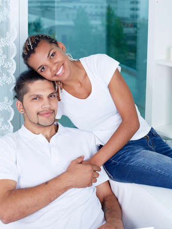 Happy young couple enjoying weekend at home photo