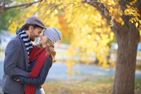 autumn young: Young couple in stylish casual-wear enjoying outdoor date