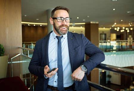 formalwear: Happy businessman in formalwear and eyeglasses