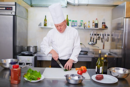vegs: Chef cutting fresh vegs at the kitchen