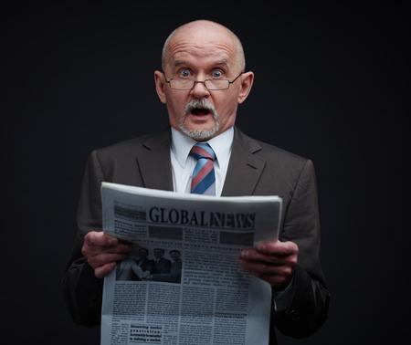 fresh news: Surprised businessman reading a fresh news