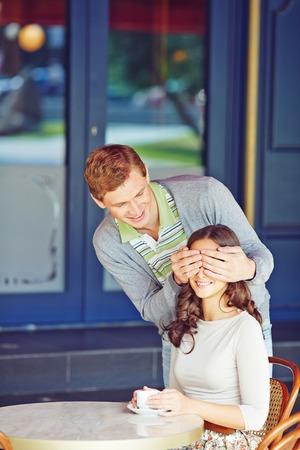closing eyes: Young man closing eyes of his girlfriend