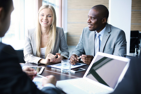 Business team discussing plans together in a meeting