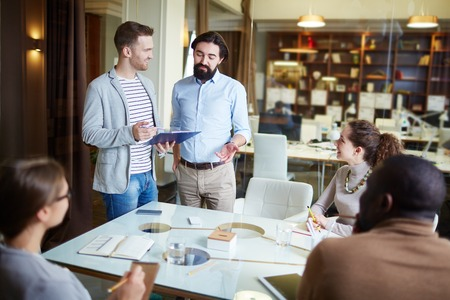 men casual: Casual business people working together at office