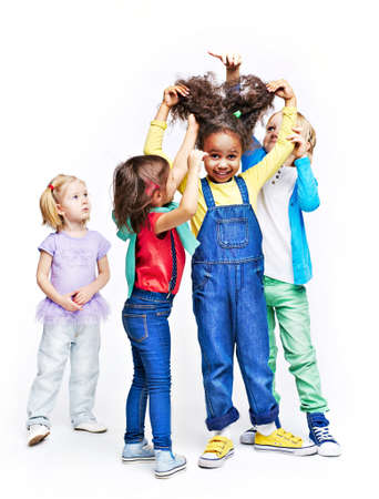standing together: Group of children making hair to their friend