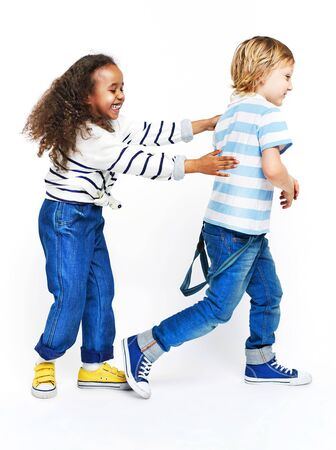 catches: Little children playing together cheerfully Stock Photo