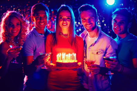 party friends: Group of happy friends with a birthday cake at a party