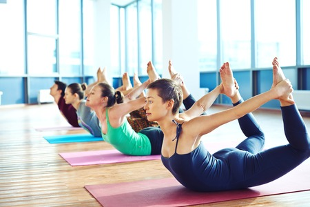 young lady: Group of young people relaxing and practicing in yoga