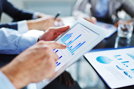 information point: Manager marking decline in revenue on financial graph