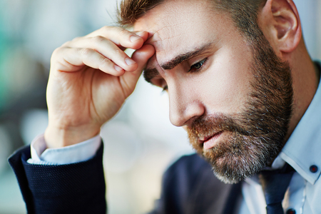 sad face: Portrait of businessman worried about something