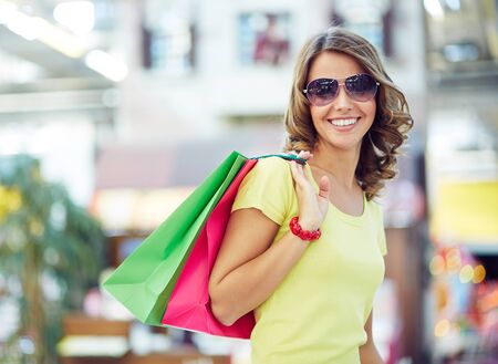 or spree: Portrait of happy woman with shopping bags Stock Photo