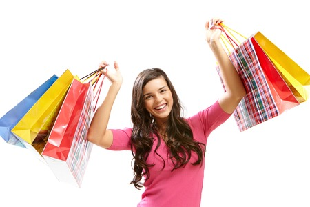 Portrait of happy young woman with shopping bags photo