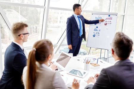 business conference: Businessman explaining plans to his colleagues at the conference Stock Photo