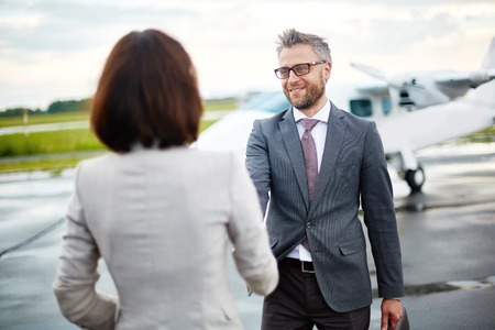 Businesswoman meeting a businessman at the airport