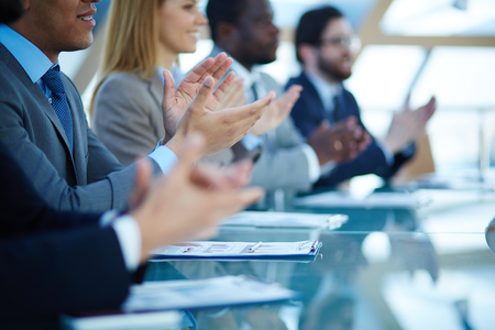 ovation: Business people applauding to speaker after presentation Stock Photo