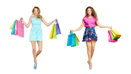 paperbags: Cheerful young shoppers with paperbags looking at camera Stock Photo