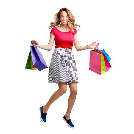shopper: Joyful shopper jumping with paperbags Stock Photo