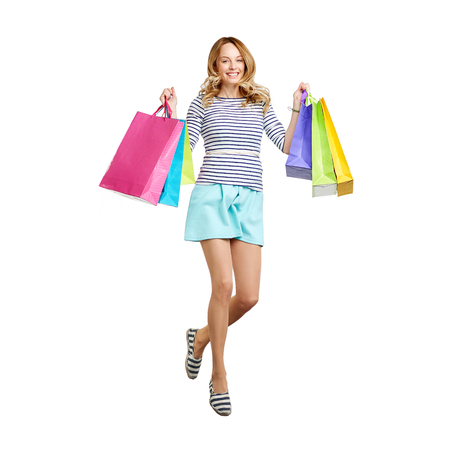 carrying girl: Young joyful consumer looking at camera with smile Stock Photo